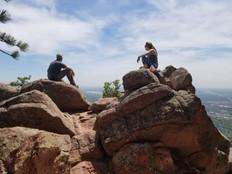 c and j sitting on rocks.jpg