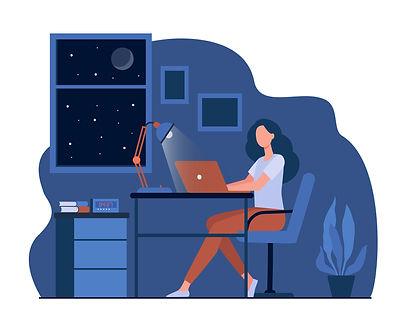 Female designer working late in room fla