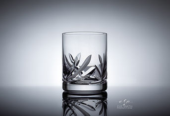 cut crystal empty whiskey glass - photo taken from the front against light backdrop.jpg