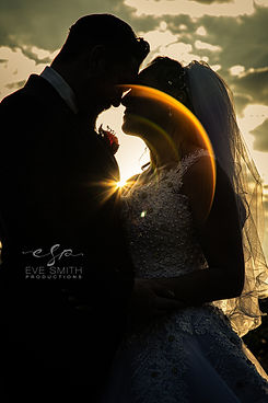 silhouette of couple touching their foreheads together during sunset