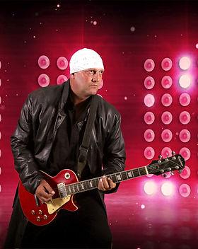 Guitar player wearing long leather coat and playing red electric guitar