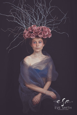 Studio photography with flower hat by Eve Smith