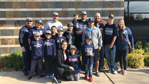 Warriors 8U Team Gives Back to Community for the Holidays