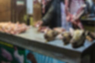 Heads of goats, meat and cicken for sale on a stand in Kathmandu Nepal
