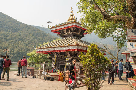 People walking around Tal Barah Temple at Phewa Lake, Pokhara, Nepal