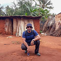 Man with hat and glasses in a rural village in Zanzibar   Shots and Tales