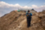 Woman arriving at Khopra Danda, Annapurna-Dhaulagiri Community Trail, Nepal