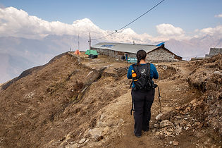 Woman arriving at Khopra Danda, Annapurna-Dhaulagiri Community Trail, Nepal