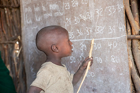 Shots and Tales | Maasai child counting numbers up to forty at a Maasai school | Oldupai Gorge Tanzania