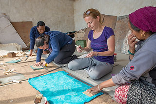Tourists making lokta paper notebooks, Nangi, Annapurna-Dhaulagiri Community Trail, Nepal
