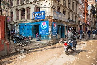 Corner shop and dirt roads in Thamel, Kathmandu Nepal