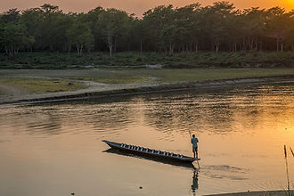 Log boat crossing Rapti river from Sauraha to Chitwan National Park, Nepal