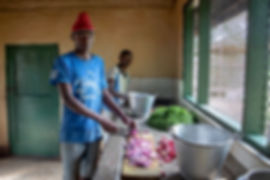 Shots and Tales | Watoto Foundation boys from Child in the Stars Project cooking in the kitchen | Arusha Tanzania