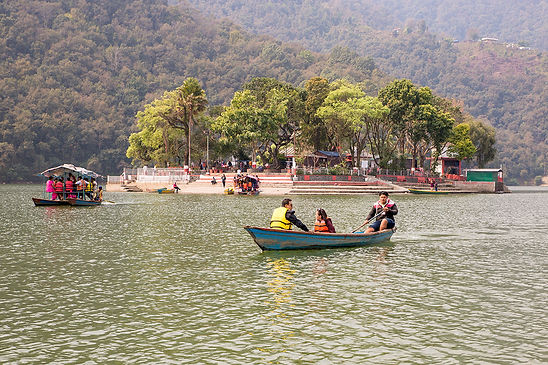 View of Tal Barahi Temple and boat across Phewa Lake in Pokhara Nepal