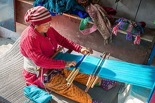 Woman weaving blue wool, Nangi village, Annapurna-Dhaulagiri Community Trail, Nepal