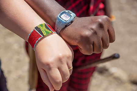 Shots and Tales | A lousy deal.  Exchanging a watch for a bracelet only to know that Maasai then sell the watches for money at a Maasai Village | Oldupai Gorge Tanzania