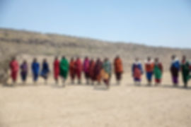 Shots and Tales | Maasai tribe men and women with traditional robes dancing | Oldupai Gorge Tanzania