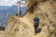 Porter arriving at Paudwar Village, Annapurna-Dhaulagiri Community Trail, Nepal