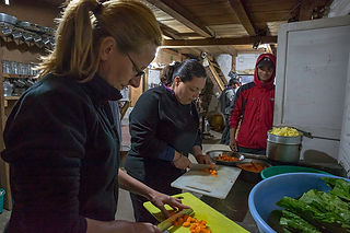 Tourists learning to cook Nepali food at Nangi Community Lodge, Annapurna-Dhaulagiri Community Trail, Nepal
