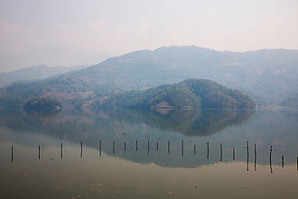 Serene and hazy atmosphere on Bengas Lake, Pokhara, Nepa