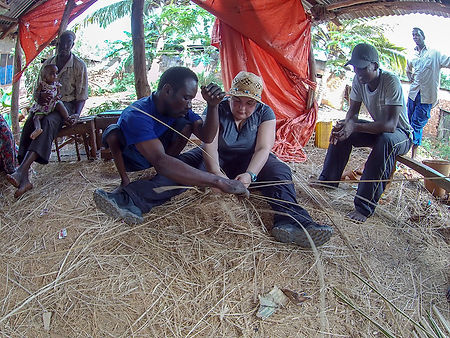 Fish net weavers, in a tent explaining the trade in Kigunda village, Red Earth bicycle tour, Zanzibar, Tanzania, Shots and Tales