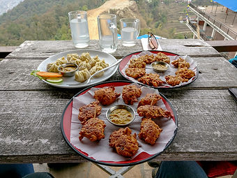 Momos and Pakora near World Peace Pagoda, Pokhara, Nepal