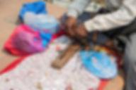 Man making key chains and bracelets at Nagarkot, Nepal