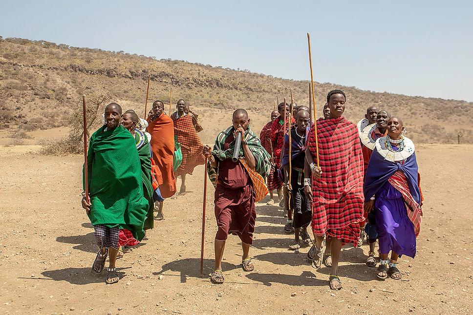 Shots and Tales | Maasai tribe men and women with traditional robes dancing | Oldupai Gorge Tanzania
