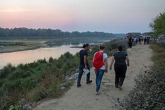People walking near Rapti river in Sauraha, Nepal