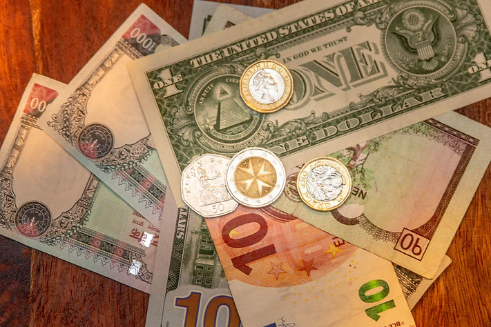 Money in different denominations Euro, Nepali Rupees, Dollars and GB Pounds | Shots and Tales