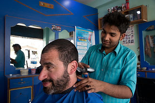 Man in barber shop in Sauraha Nepal