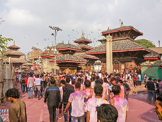 Crowd during Holi – festival of colours in Durbar Square Kathmandu Nepal