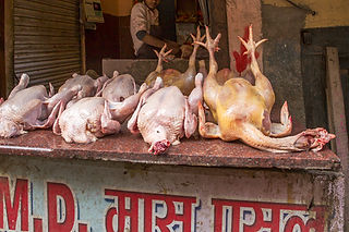 Chicken for sale on a stand in the streets of Kathmandu Nepal