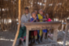 Shots and Tales | School children singing for tourists at the village school hut in a Maasai boma | Oldupai Gorge Tanzania