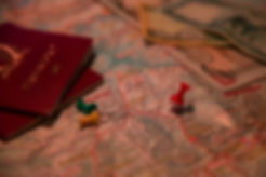 Passports, trekking map and pins, showing planning in progress