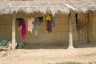 Clothes hanging to dry in Tharu mud houses in Sauraha, Nepal