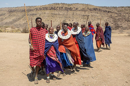 Shots and Tales | Maasai tribe men and women with traditional robes singing and dancing | Oldupai Gorge Tanzania