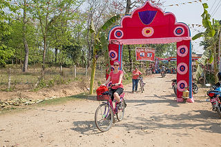 Riding a bicycle in Sauraha Nepal