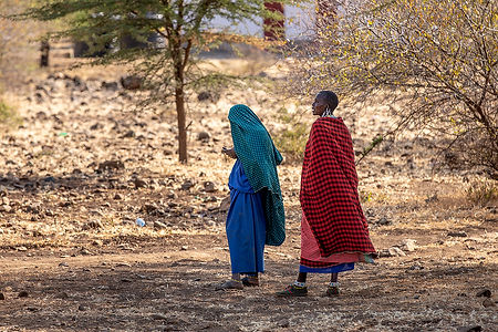 Shots and Tales | Maasai tribe people wearing red and blue traditional clothes | Near Ngorongoro Crater Tanzania