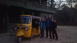 Tuk tuk and people in front of Night Tower Watch in Sauraha, Napal