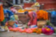 Woman selling marigold garlands and flowers in Kathmandu, Nepal