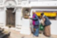 Women turning Buddhist Prayer Wheels at Boudhanath, Boudha Stupa, Kathmandu, Nepal