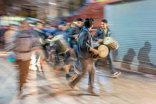 People playing drums at night on the streets of Kathmandu Nepal