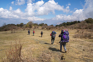 People trekking from Mohare Danda to Danda Kharka, Annapurna-Dhaulagiri Community Trail, Nepal