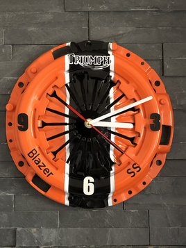 Triumph Clock