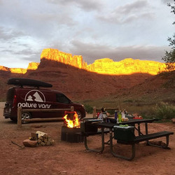 Watching the sun set against the red rocks of #moab