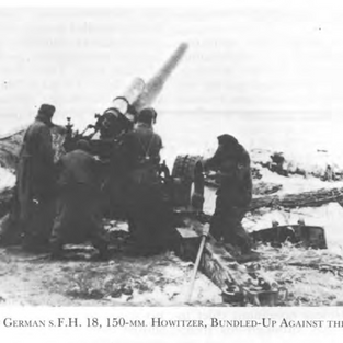 A German Howitzer crew bundled up against the cold