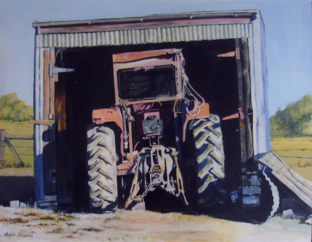 Tractor in shed.