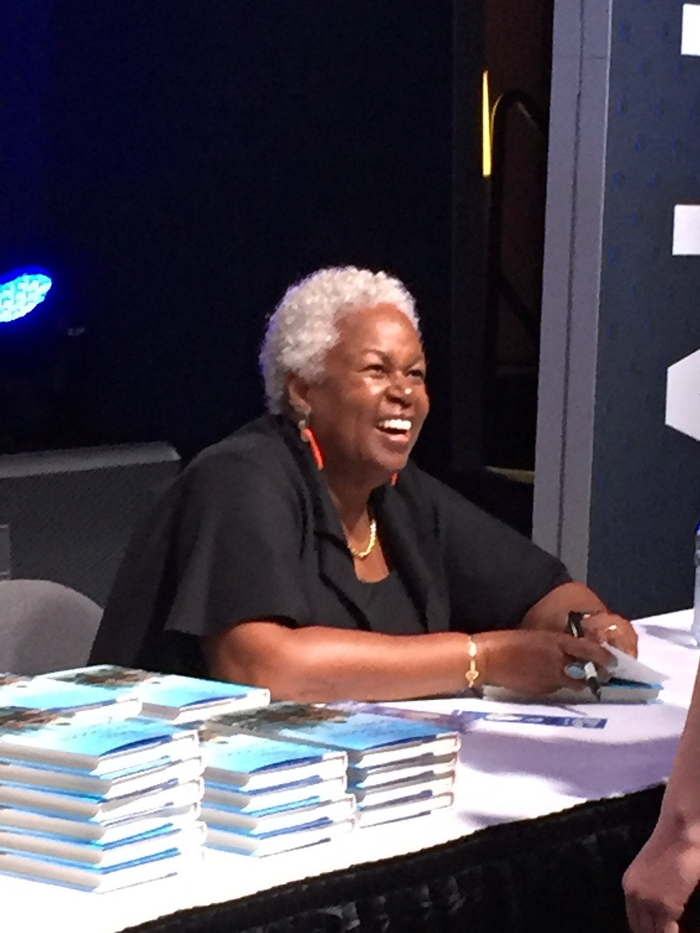 Sharon Robinson Greets fans and signs books.