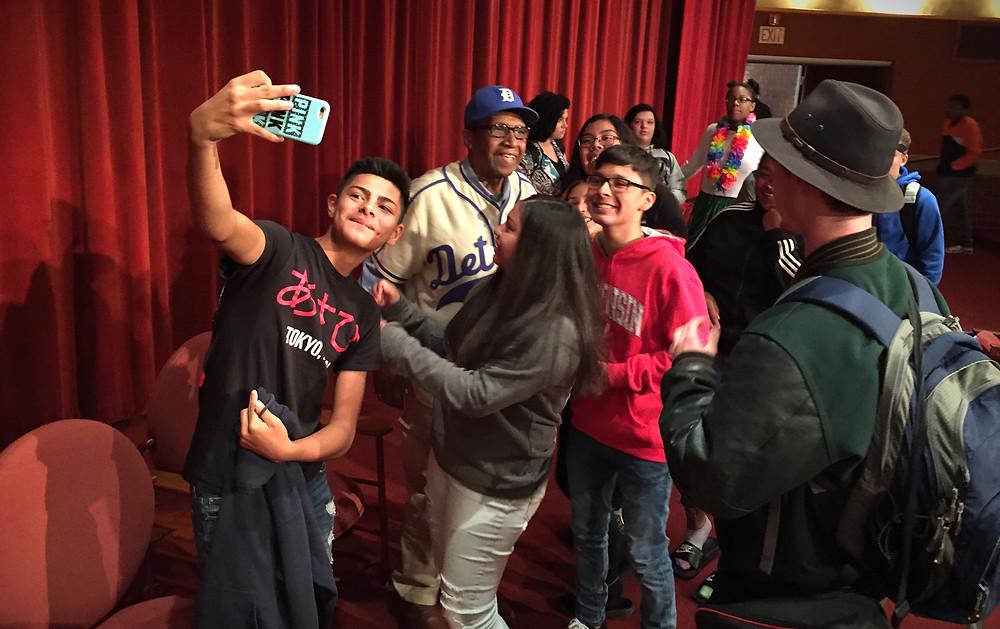 HS Kids enjoying a selfie with Negro League Baseball Player